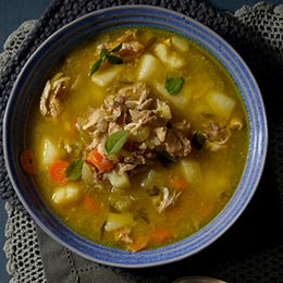 Chicken, potato and vegetable soup with basil